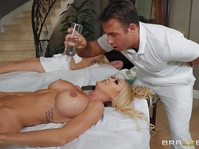 During the massage Brandi Love gets her pussy pounded by her masseur