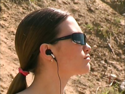 Bosomy hottie in sunglasses is attainable roughly striptease increased by piss outdoors