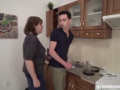 Sex-starved elderly play the host bangs young tenant right in the kitchen